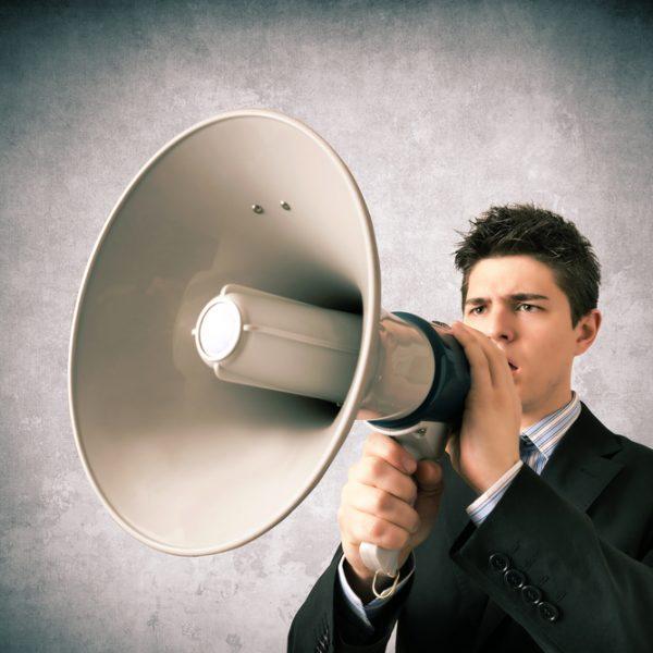 ВКонтакте АКАР Young business man speaking with a megaphone трафика WEX ВКонтакте Mail.Ru