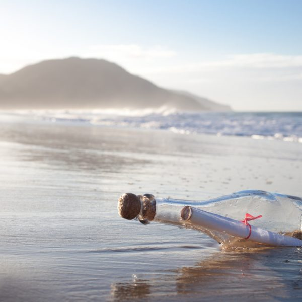 A message inside a glass bottle, washed up on a remote beach